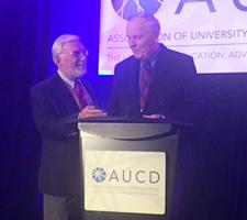 David R. Johnson receives award from George Jesien.