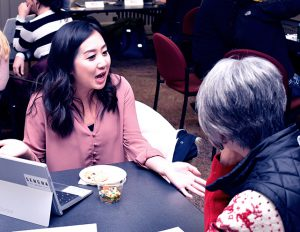 Crystal Yang describes her New Challenges, Inc. experience to Asst. Professor Joyce Serido.