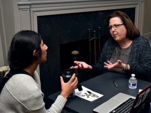 Johanna Villa (left) and Assoc. Professor Virginia Zuiker discuss Villa's experience at the Seward Child Care Center.