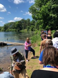 Photo of Summer Institute attendees on the shore of a lake