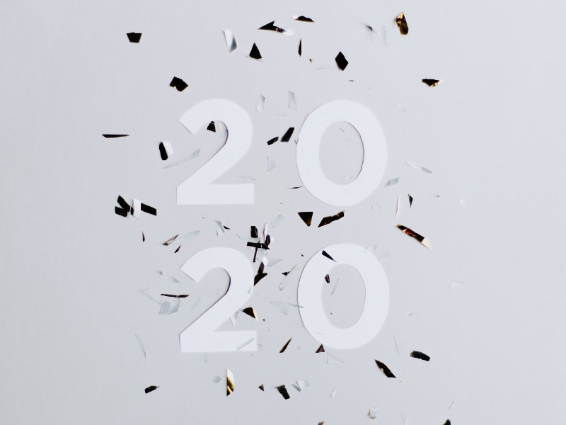 Confetti and paper cut-outs of the number 2020